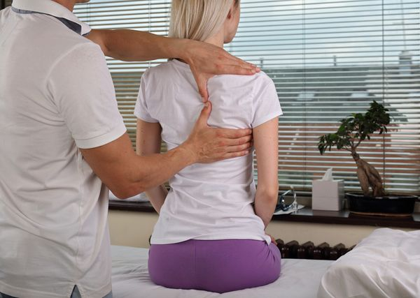 woman receives chiropractic care