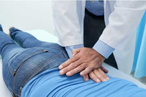 Woman on table getting chiropractic adjustments in Cape Coral