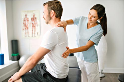 Young man getting chiropractic care for muscle strains